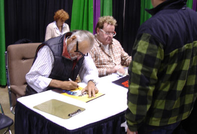 George Romero signs for a fan
