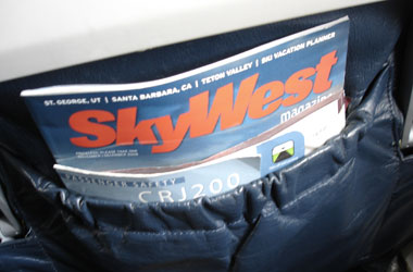 SkyWest magazine with the inflight safety manual