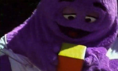 Baby Grimace shakes a box